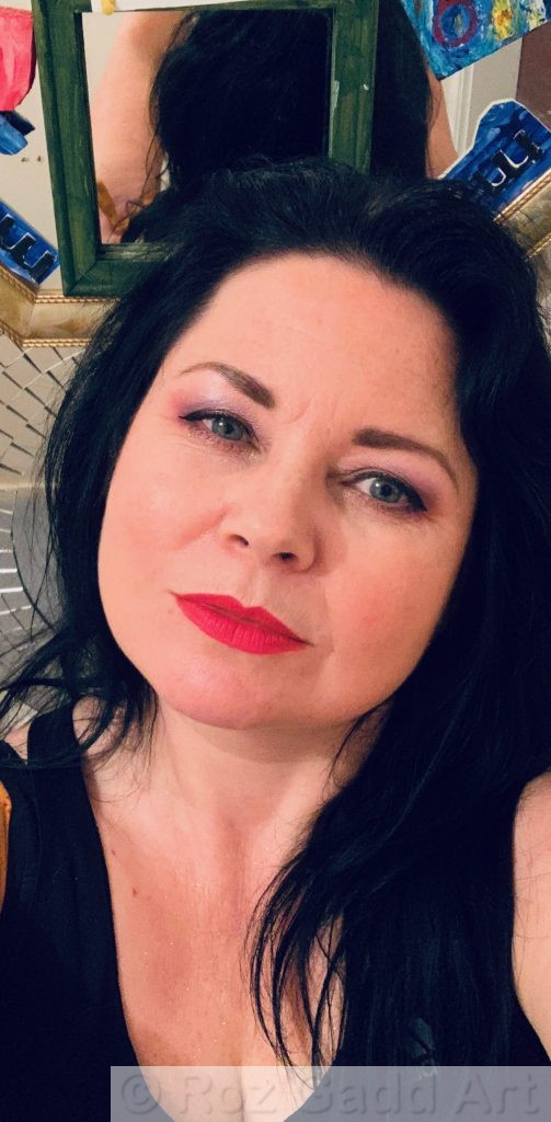 photo of woman with long black hair and red lipstick
