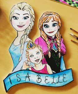Photo of a door hanger with Elsa and Ana from Frozen