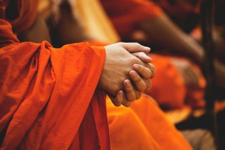 buddhist monk hands clasped