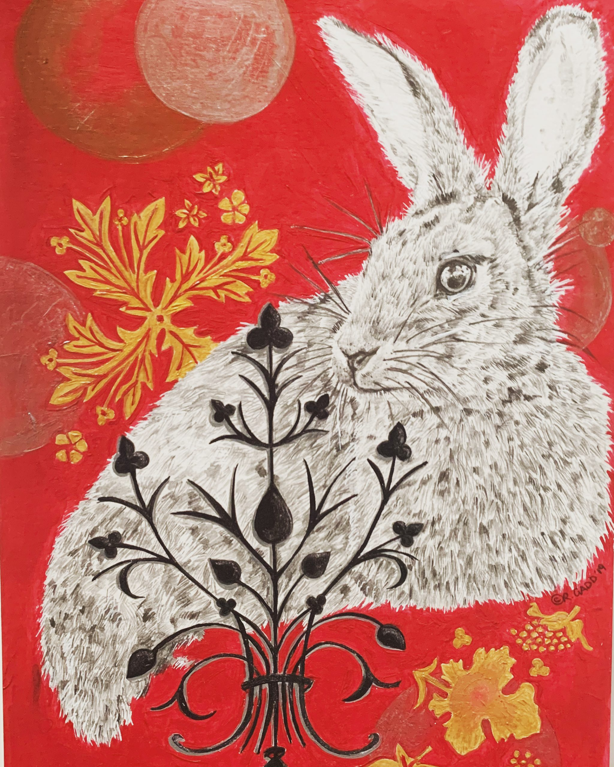 Pencil drawinf of rabbit gold and black patterns on red background