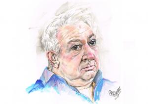 Portrait of older man wearing a blue shirt