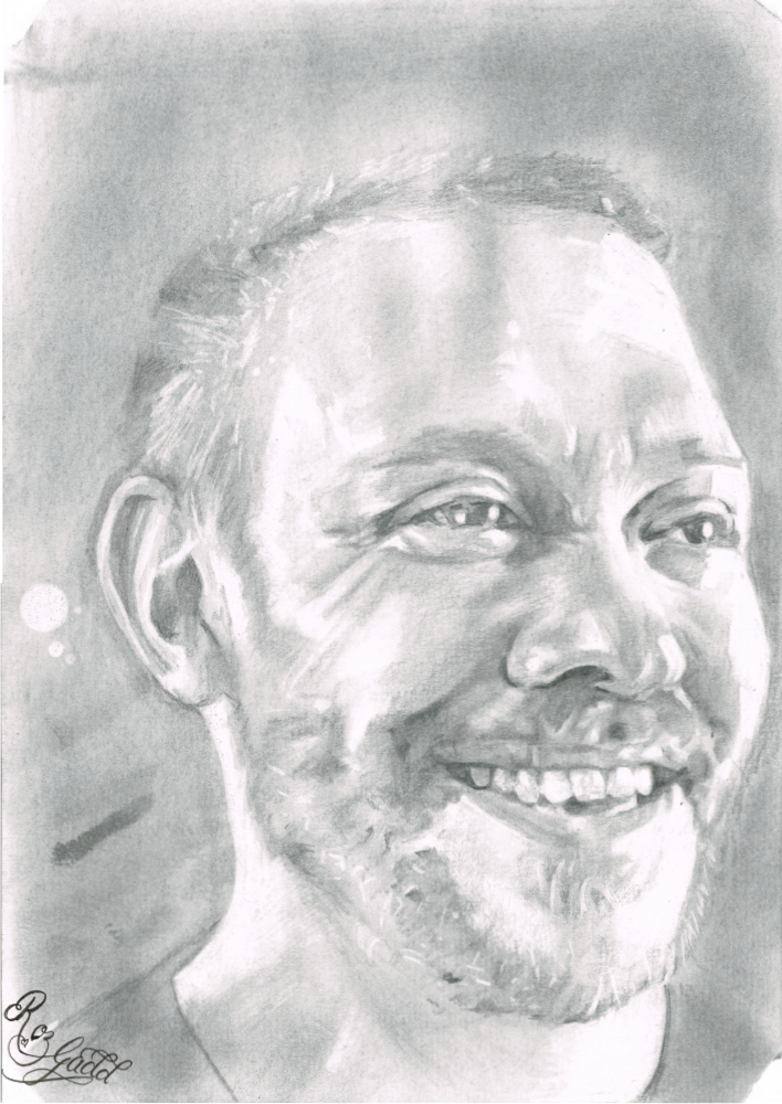 Portrait of man smiling looking to his left