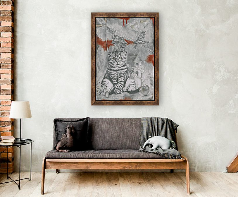 room with sofa and on wall is large drawing with cat